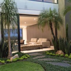 Jardines de piedra de estilo  por homify, Moderno