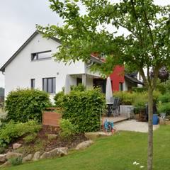 Haus am Hang:  Holzhaus von Herrmann Massivholzhaus GmbH