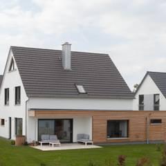 Wooden houses by Herrmann Massivholzhaus GmbH,