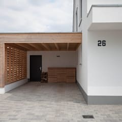Carport by Herrmann Massivholzhaus GmbH, Modern Solid Wood Multicolored