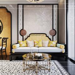 XU HƯỚNG ĐÔNG DƯƠNG ẤN TƯỢNG - Thiết kế căn hộ Vinhomes Golden River:  Phòng khách by ICON INTERIOR