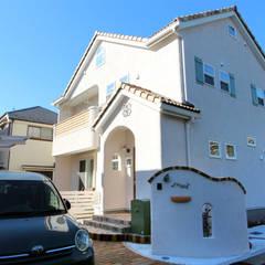 戸建住宅用・宅配ボックス「Brizebox - ブライズボックス」: ボウクス株式会社が手掛けた庭です。
