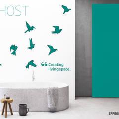 Porta Ghost Scorrevole esternu muro: Porte in stile  di Effebiquattro S.p.A.