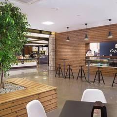 Cafetaria: Adegas  por PRX Gabinete de Arquitectura, Lda