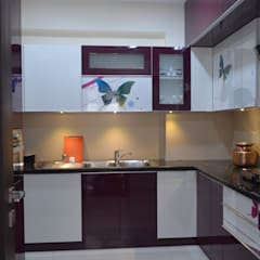 A SUMPTUOUS 3 BHK APARTMENT: modern Kitchen by Vdezin Interiors