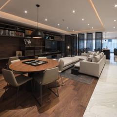 Departamento HL: Salas multimedia de estilo moderno por Concepto Taller de Arquitectura