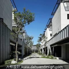 如同帽沿的建築頂面:  別墅 by 大桓設計顧問有限公司