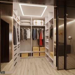 Closets de estilo  por Студия дизайна интерьера L'grans