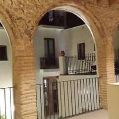 REHABILITACION DE CASA RURAL: Terrazas de estilo  de P. CAMP RODERO SL