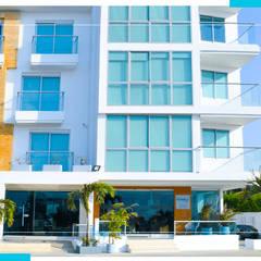 hotel summers: Habitaciones de estilo  por construcciones y soluciones integrales s.a.s