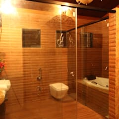 APPLE POOL VILLA:  Bathroom by The Designs