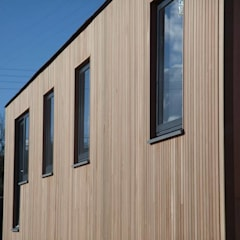 Exterior Cladding:  Wooden houses by Building With Frames