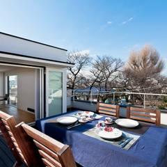 ハコ型二世帯住宅 ハコノオウチ05: 石川淳建築設計事務所が手掛けたテラス・ベランダです。