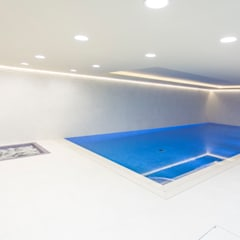 Luxury basement pool and spa:  Infinity pool by London Swimming Pool Company