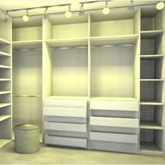 Closet de Casal : Closets modernos por Studio Elabora