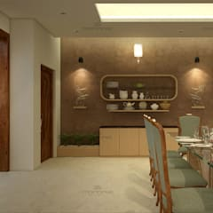 Dining room by Monnaie Interiors Pvt Ltd