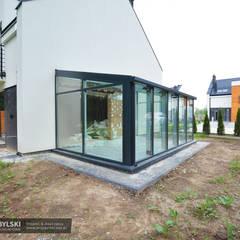 Nowoczesny ogród zimowy : styl , w kategorii Ogród zimowy zaprojektowany przez P.W. Przybylski