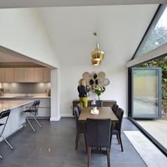 Architect designed roof and kitchen house extension Kingston KT2 - Dining area:  Dining room by GOAStudio | London residential architecture