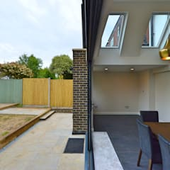 Kingston KT2 | Roof and kitchen house extension:  Dining room by GOAStudio | London residential architecture, Rustic