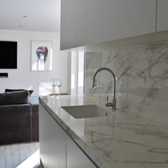 Docklands apartment:  Kitchen by Place Design Kitchens and Interiors