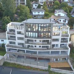 Vista al Lago: Condominios de estilo  por Aguirre Arquitectura Patagonica