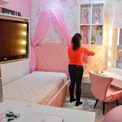 Três mundos em um só família Marchi: Quartos das meninas  por ALB Interiores