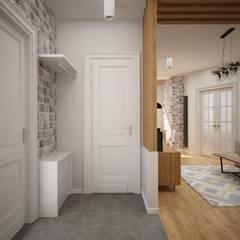 Pasillos y vestíbulos de estilo  por дизайн-бюро ARTTUNDRA
