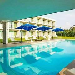 Hotel Aqua: Bungalows de estilo  por Espacio Interior