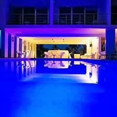 Hotel Aqua: Albercas infinity de estilo  por Espacio Interior