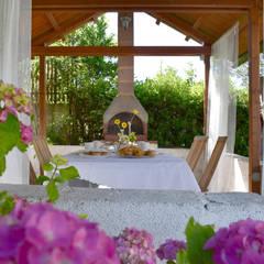 Relooking B&B: Giardino in stile  di Sonia Santirocco architetto e home stager