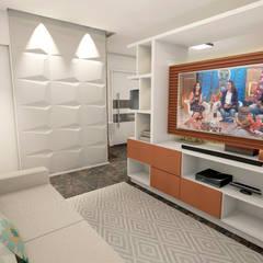 Sala de tv: Eletrônicos  por Ladrilho Urbanismo e Arquitetura