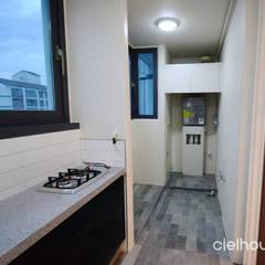 밝고 환하게 바뀐 40평대 아파트 인테리어: 씨엘하우스의  베란다,모던