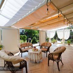 Ogród zimowy wnętrze: styl , w kategorii Ogród zimowy zaprojektowany przez P.W. Przybylski