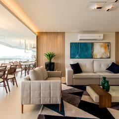 Apartamento de luxo com estética clean: Salas de estar  por Espaço do Traço arquitetura,