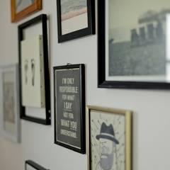 お子様の成長の証もインテリアとして。: 有限会社グラデンパシフィックが手掛けた壁です。