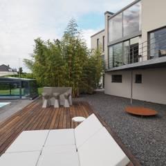 Villa mit Pool:  Villa von Bolz Licht & Wohnen