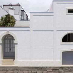 Apulia House AA: Case in stile  di De Vivo Home Design