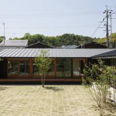 L字の家: toki Architect design officeが手掛けたロックガーデンです。,モダン 石