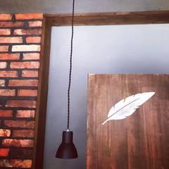 마리아엘레나 칵테일 바: 디자인브라더스의  거실
