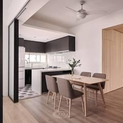 Comedores de estilo escandinavo por 層層室內裝修設計有限公司