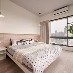 無印簡約風放鬆宅:  臥室 by 層層室內裝修設計有限公司