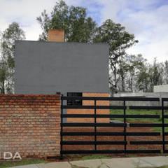 Casa Estudio La Campiña: Casas de estilo industrial por MIDA