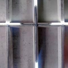 Luminarias: Oficinas y tiendas de estilo  por Estudio Chipotle