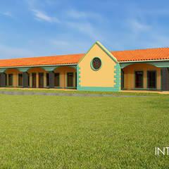 Fachada : Estudios y oficinas de estilo clásico por Interacción Arquitectos