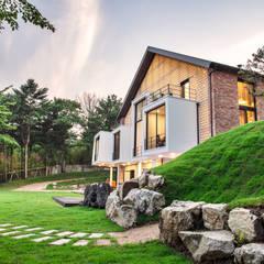 Houses by 위 종합건축사사무소