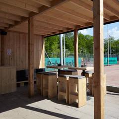 NTC Nijkerk: industriële Eetkamer door Molitli Interieurmakers