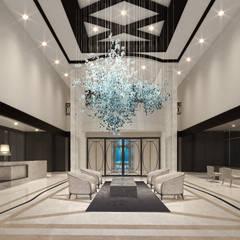 Recepción de un condominio : Hoteles de estilo  por Claudia Luján, Moderno Mármol