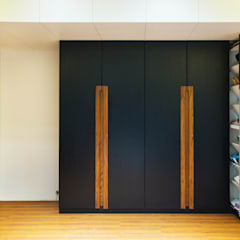 Dormitorios de estilo  por Urbane Storey