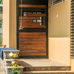 Front doors by Rawat Design Studio