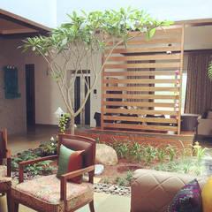 VILLA 46, EKTHA PRIME-GACHIBOWLI, HYDERABAD: rustic Living room by Crafted Spaces